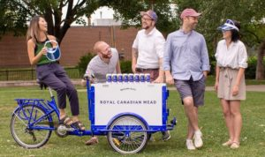 Royal Canadian Mead team surrounding their Marketing bike with bottled Royal Canadian Mead in Hamilton Ontario.