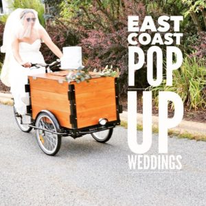 "A bride riding a custom stained cedar box ice cream bike down the street and big text ""East Coast Popup weddings"""