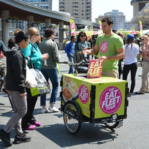 The Eat Fleet Tour OOH sampling goods out of a marketing Icicle Tricycles Ice Cream Bike Sampling Cart on the Canadian National Tour in Vancouver British Columbia